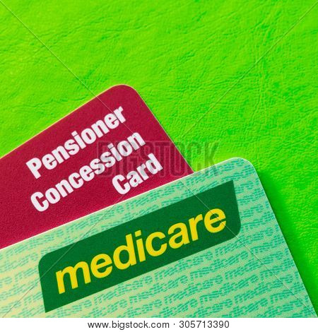 Australian Medicare and Pensioner Concession cards over vibrant green background with copy space.