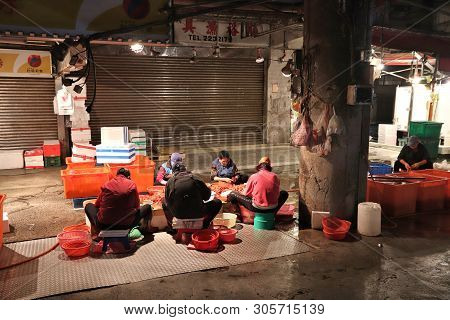 Keelung, Taiwan - November 22, 2018: Vendors Prepare Shrimp At Famous Kanziding Fish Market In Keelu