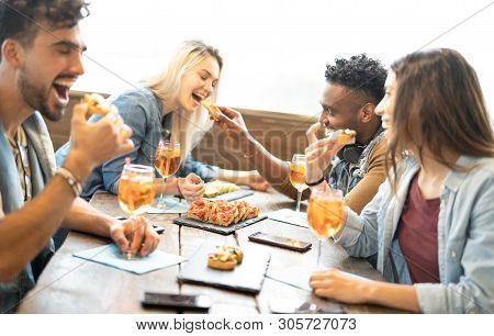 Friends Eating And Drinking Spritz At Fashion Cocktail Bar Restaurant - Friendship Concept With Youn