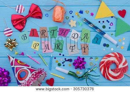 Happy Birthday Background With Party Supplies. Birthday Decor On Blue Wooden Background. Birthday De