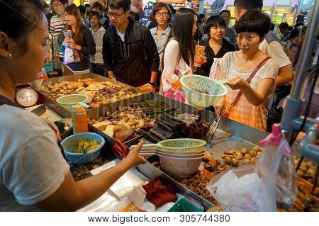 Taipei, Taiwan - July 13, 2013: Customers Ordering Chinese Street Food Consisting Of Braised Beef An