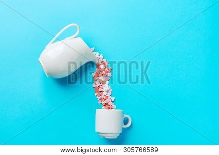 Multicolored Sugar Candy Hearts Imitating Pouring Liquid Coffee Tee From White Milk Jug Pitcher Into