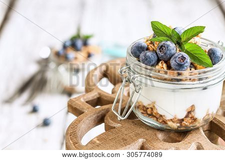 Healthy Breakfast Of Blueberry Parfaits Made With Fresh Fruit, Greek Yogurt, Granola And Mint Leaves