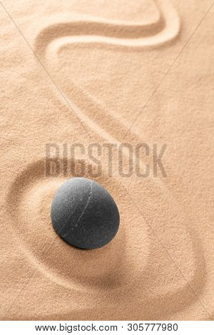 Zen meditation Japanese stone and sand garden with raked line. Concept for concentration and focus for purity, harmony and balance. Background with copy space.
