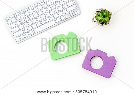 Office Desk Of Blogger With Camera, Keyboard And Plant On White Background Top View