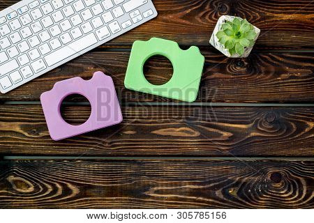 Blogger Table Design With Photo Camera, Keyboard And Plant On Wooden Background Top View Mockup