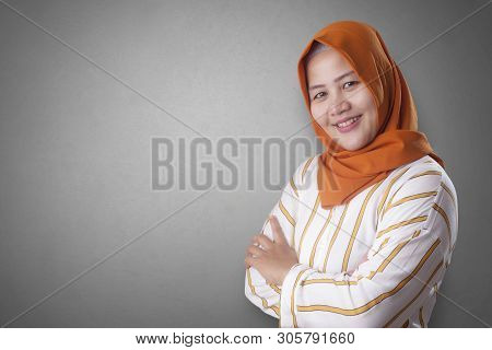 Successfull Happy Asian Muslim Woman Wearing Hijab Smiling Friendly With Arms Crossed, Confident Str