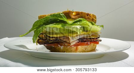 Deli Sandwich On A Plate With Luscious Filling