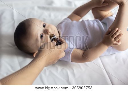 A Doctor Gives Newborn Baby Rotavirus Vaccine. Child Immunization With Little Drop In Clinic. Baby B