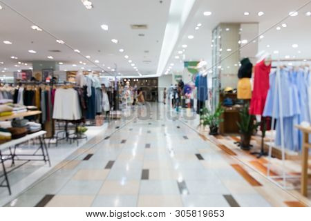 Blurred Showcases Fashion Boutique Clothing Store In A Modern Shopping Mall. Cloth And Acessorie Mod