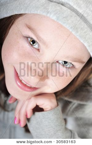 Young girl with freckle face smiling