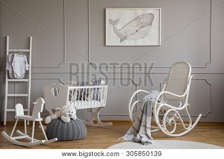 Grey Whale On Poster In Classy Baby Room Interior With White Wooden Rocking Chair, Rocking Horse, Cr
