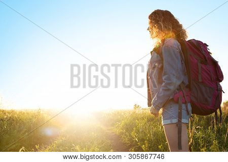 A World Without Borders. Stunning Journey Of Girl In The Mountains. Young Blonde Caucasian Woman Tra