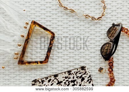 Fashionable Female Accessories: Sunglasses, Chain With Gold Shells And Gemstone, Ring, Cosmetic Bag