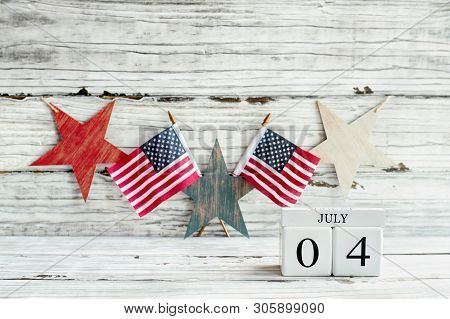 July 4Th Calendar Blocks Against Rustic Background