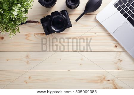 Top View Of Photographer Desk With Latptop, Camera And Lenses With Copy Space. Flat Lay Shot On Wood