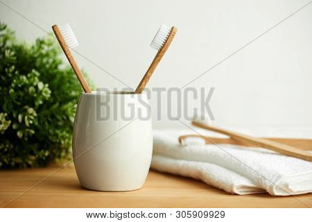 The Bamboo Toothbrushes In A Gray Glass With Copy Space