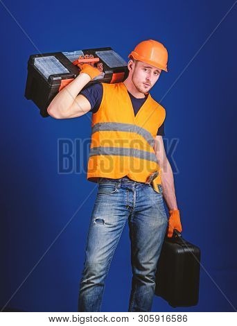 Worker, Repairer, Repairman, Builder On Calm Face Carries Toolbox On Shoulder, Ready To Work. Repair