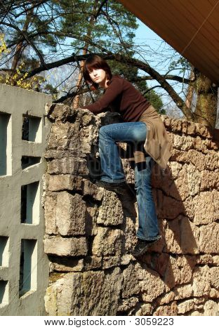 Girl On The Stone Wall