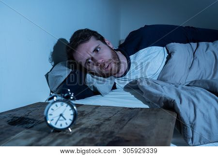 Insomnia Stress And Sleeping Disorder Concept. Sleepless Desperate Young Caucasian Man Awake At Nigh