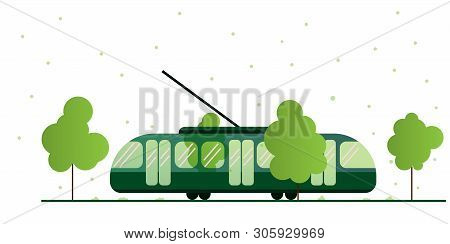 Tram Surrounded By Nature. Tram Lines In An Urban Environment In Summer With Green Trees. Eco-friend