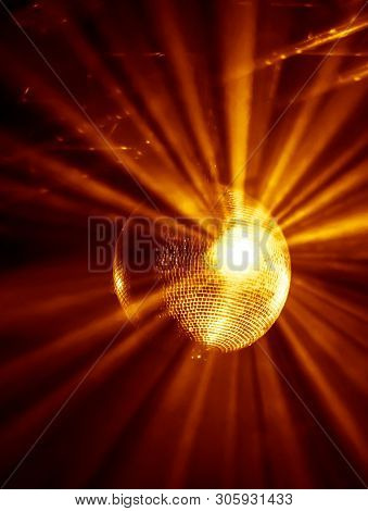Disco ball with bright yellow rays