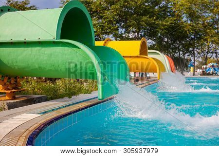 Blue waterpark on sky background
