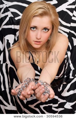 Sexy Woman Stretches Out Her Hands In Chains