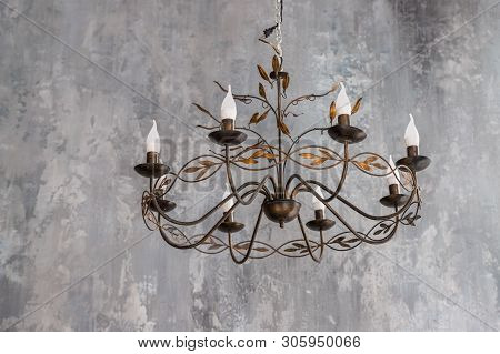 Luxurious Black Metal Chandelier Hanging On The Ceiling.contemporary Chandelier, Is A Branched Ornam