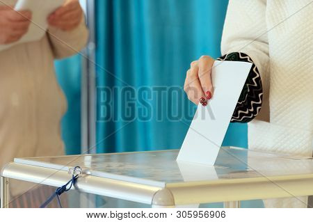 Nationwide Voting, Elections. The Hand Of A Girl With A Beautiful Manicure Lowers The Ballot Into A