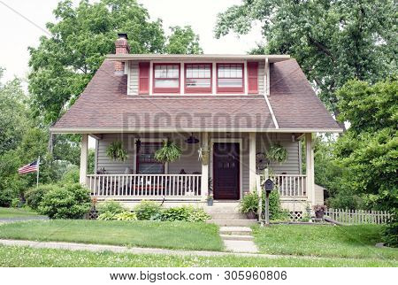 Homey Cottage with Long Dormer & Front Porch with Railing