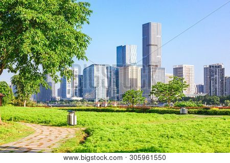 Cityscape and skyline of Fuzhou from green field in park,Fuzhou,China