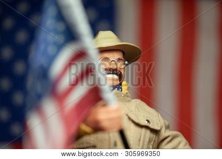 JUNE 1 2019: Theodore Teddy Roosevelt waving American flag, San Juan Hill battle recreation, US - Cuba - Spain war  - Hasbro GI Joe series action figure
