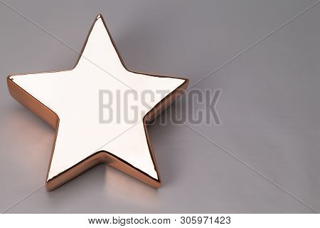 Image Shows An Golden X-mas Star, Isolated On Grey Background With Space For Text