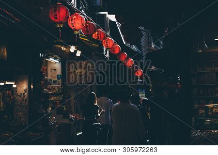 Jiufen, Taiwan - November 07, 2018: A Young Woman Walks In The Crowd At The Old Street Market On Nov