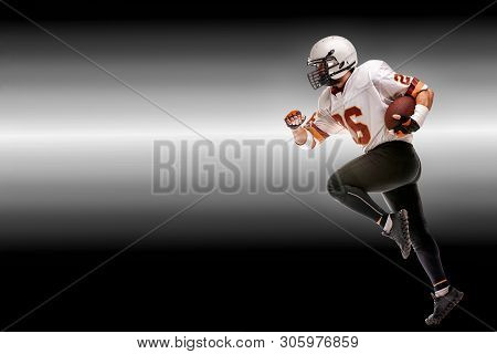 Concept American Football, American Football Player With Ball In Hand. Black White Background, Copy