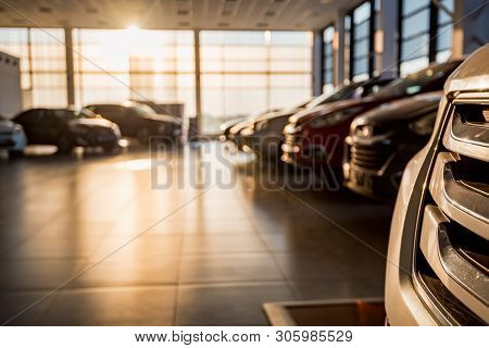New Cars At Sunlit Dealer Showroom Close View