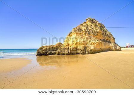 Rocks and ocean at Praia Tres Irmaos in Alvor Algarve Portugal