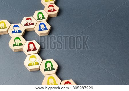 Symbols Of Employees On The Chains Of Hexagons. The Concept Of Business Connections. Team Building,