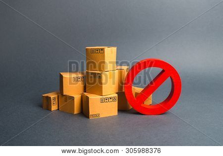 Many Cardboard Boxes And A Red Symbol No. Embargo, Trade Wars. Restriction On The Importation Of Goo
