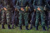 Soldiers stand in row. Gun in hand. Army, Military Boots lines of commando soldiers in camouflage uniforms Thailand poster