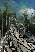 very old suspension bridge with wooden footstep poster