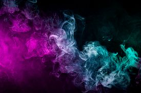 Dense Multicolored Smoke Of   Blue And Purple Colors On A Black Isolated Background. Background Of S