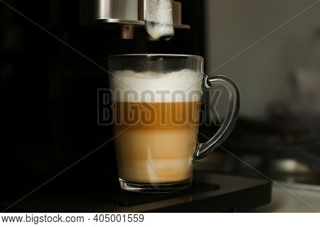 Making Coffee In A Coffee Machine At Home. Boil And Beat Process. The Finished Coffee Has Three Laye