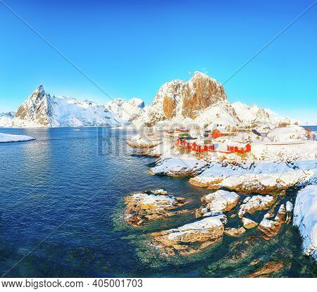 Outstanding Winter View On Hamnoy Village And Festhaeltinden Mountain On Background. Popular Tourist
