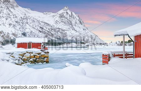 Dramatic Winter Scenery With Traditional Norwegian Red Wooden Houses On The Shore Of Rolvsfjord On V