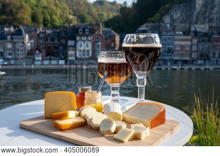 Glass Of Belgian Abbey Beer And Tasting Of Cheeses Made With Trappist Beer And Fine Herbs With View
