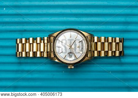 Rolex Oyster Perpetual Day- Date Watch On Metal Background