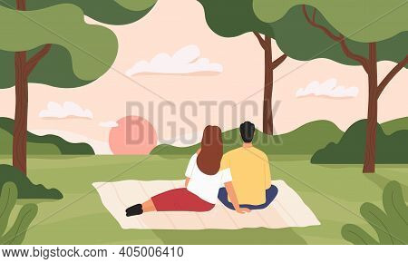 Couple In Forest. Man And Woman Hugging And Looking At Sunset In Park. Romantic Picnic In Summer For