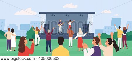 Open Air Concert. People Enjoying Outdoor Performance With Musician Band On Stage. Crowd Listen And